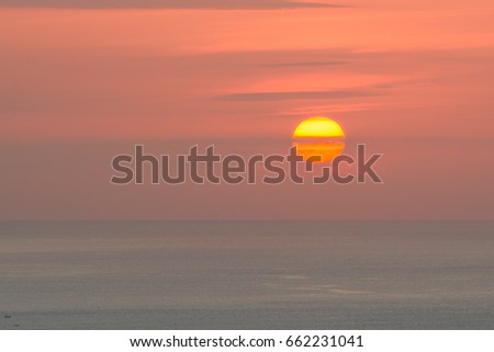 beautiful red sunrise over the ocean #662231041