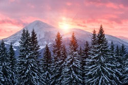 beautiful red sunset in winter mountain