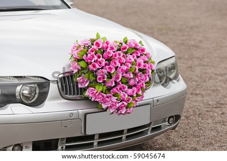 stock photo Beautiful red wedding bouquet on the car