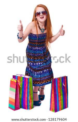 Beautiful redhead girl with shopping bags
