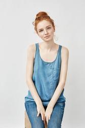 Beautiful redhead model smiling looking at camera.