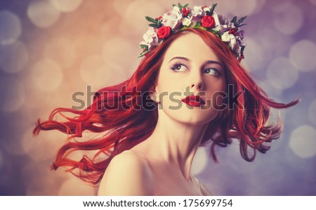 Beautiful redhead women with wreath.