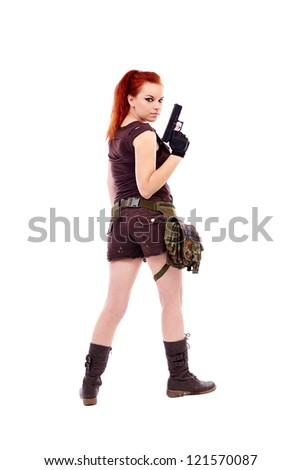 Beautiful redhead young woman with gun, holster and military outfit, isolated on white background