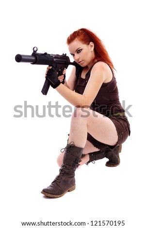 Beautiful redhead young woman with machinegun, holster and military outfit, isolated on white background - stock photo