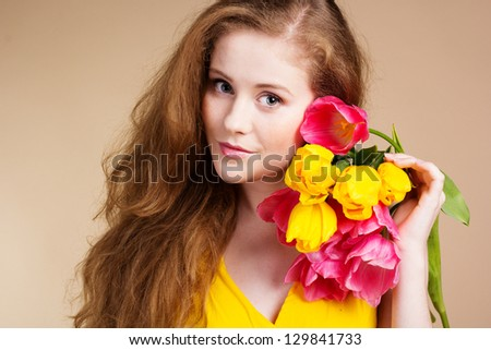 Beautiful redheaded girl with tulips