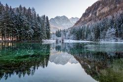 Beautiful reflection in lake, Slovenia Plansarsko jezerko, Zgornje Jezersko at winter. Holidays destination, hiking.