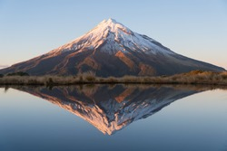 Beautiful reflection mountain and blue lake, Taranaki, New Zealand.