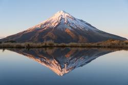 Beautiful reflection mountain and blue lake, Taranaki, New Zealand.