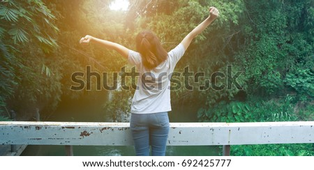 beautiful Refreshed woman in the forests And warm light ストックフォト ©