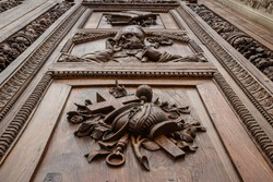 Beautiful renaissance wooden door of the cathedral Santa Maria del Fiore in Florence, Italy