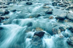 Beautiful Reshi River water flowing through stones and rocks at dawn, Sikkim, India. Reshi is one of the most famous rivers of Sikkim flowing through the state and serving water to many local people.