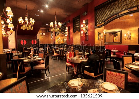 beautiful restaurant with a romantic couple eating
