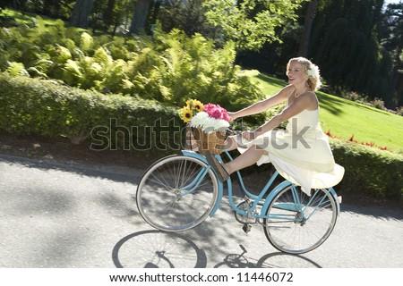 Beautiful retro girl rides her bike playfully