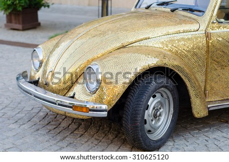 Beautiful retro glod covered car.
