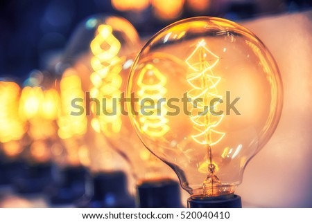 Beautiful retro luxury light bulb decor glowing for abstract background. Holiday or party background.