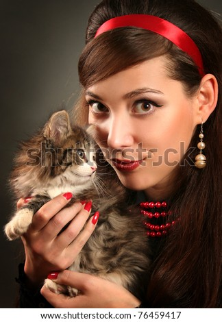beautiful retro woman with kitten