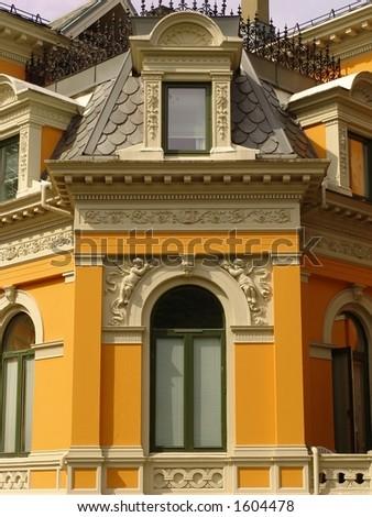 Beautiful rich details of a bright yellow/orange building at Parkveien, Bergen, Norway
