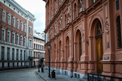 Beautiful Riga city architecture with old buildings and brick streets. Photo taken in Europe, Latvia, Riga.