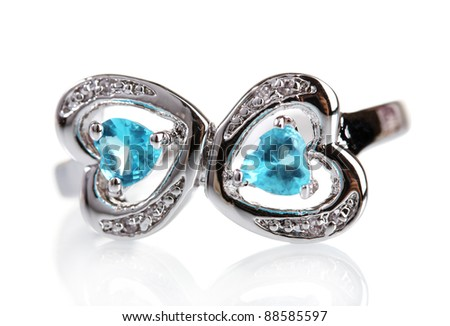 beautiful ring with blue precious stones isolated on white