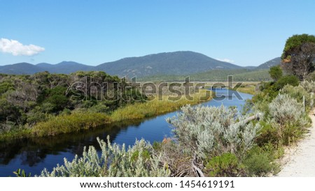 Beautiful river with mountain background, river mountain,river against mountain during sunny day