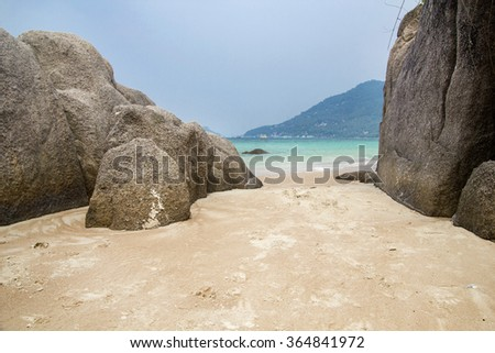 Beautiful rock beach with sea ocean and mountain blue sky landscape background #364841972