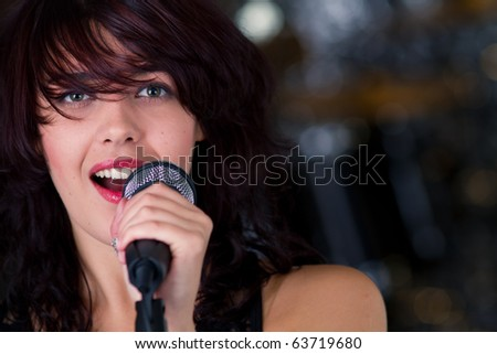 Beautiful rock singer with microphone