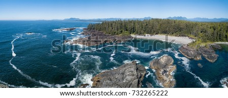 Beautiful rocky beach landscape at Pacific Ocean Coast. Picture taken South of Wickaninnish Beach near Tofino and Ucluelet on Vancouver Island, British Columbia, Canada.