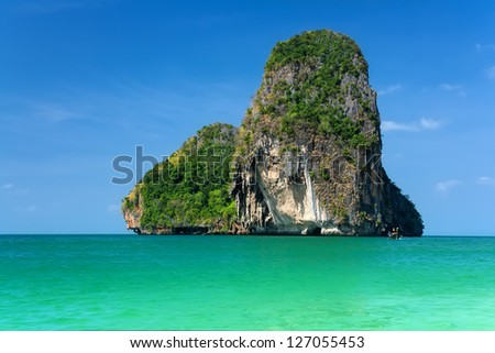 Beautiful rocky island over blue sky