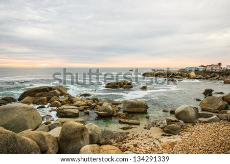Beautiful rocky seascape in Cape town city shot during sundown