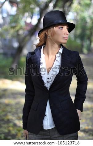 Beautiful romantic girl in the autumn street