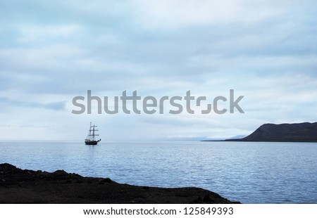 Beautiful romantic view, Sailing ship docked at Longyearbyen port against the background of blue cloudy sky at morning in Advent Bay, Spitsbergen archipelago (Svalbard island), Norway, Greenland Sea  #125849393