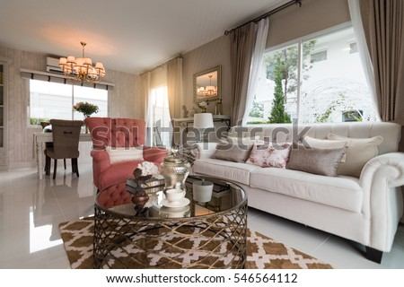 Beautiful room interior with hardwood floors and view of new luxury home.