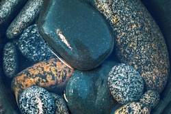 Beautiful Round river stones on the bank of a beautiful river. A true beauty and miracle of nature.