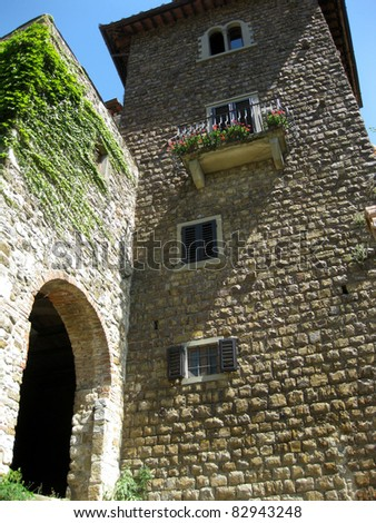 Beautiful rural arch and tower in the old village Montefioralle in Chianti's countryside, Tuscany, Italy