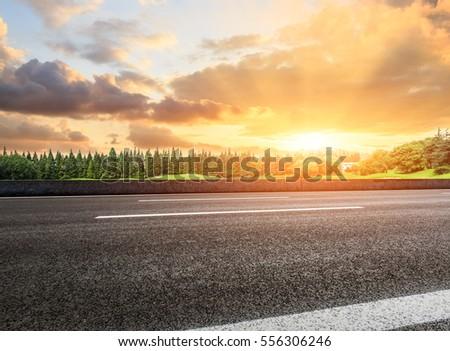 Beautiful rural asphalt road scenery at sunset #556306246