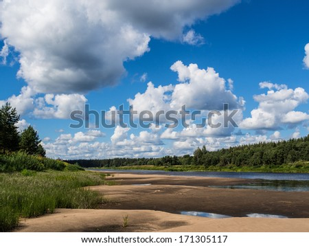Beautiful rural landscape. A clear flying weather after a thunder-storm. Big beautiful cloud over the river