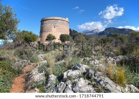 Beautiful rural landscape of mediterranean island Mallorca, sunny day in mountain region with medieval tower Stok fotoğraf ©