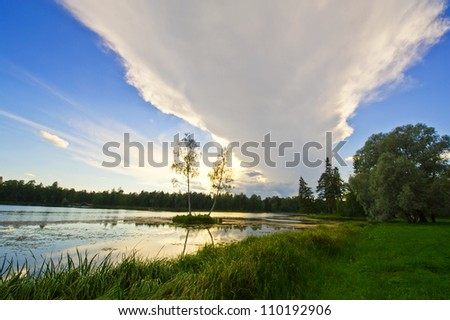 Beautiful rural landscape with a lake and sky reflected