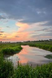 Beautiful rural scenery near the lake in warm sunset light