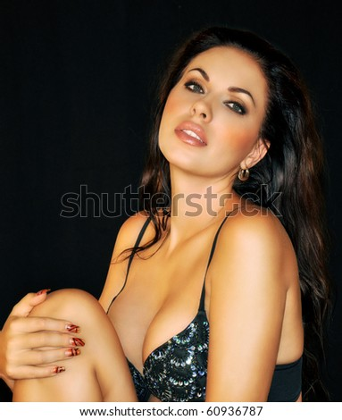 beautiful Russian brunette with sensual sexy look on black background