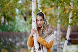 Beautiful Russian girl in Russian folk costume. Russian style. Pavlo-Posad shawl. Traditional dress of Russian townspeople