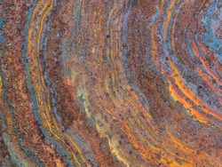 beautiful rust rings on an old metal surface