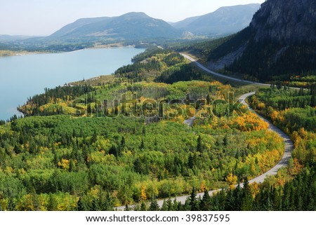 Beautiful s shape winding road in autumn forests, kananaskis country, alberta, canada