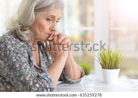 Beautiful sad elderly woman