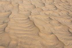 Beautiful sand and wind pattern in the desert. Unusual sandy texture