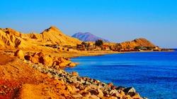 Beautiful sandy beach in Sinai Peninsula, where desert meets Red Sea, near Nuweba, Egypt, Middle East