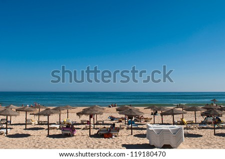 beautiful sandy beach with coconut parasols in Manta Rota (Algarve), Portugal