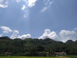 Beautiful scenary of hill under blue sky and white clouds landscape