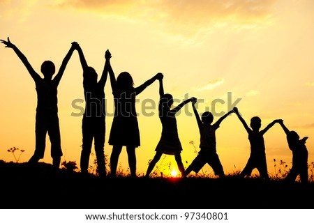 Beautiful scene of children in nature with sky in background