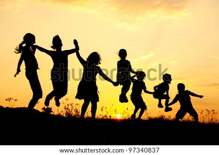 Beautiful scene of children jumping in nature